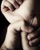 Photo: hand grabbing wrist
