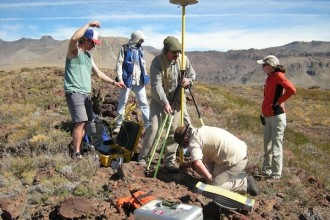 Photo: students and professor working at volcano site