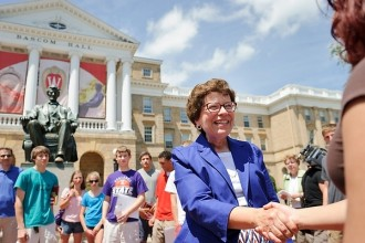 Photo: Rebecca Blank shaking hands with student