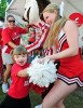 Photo: little girl dancing with cheerleader