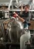 Photo: man using brewing vat