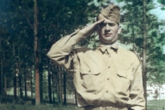 Photo: tinted photo of Pvt. Gordon in uniform, saluting