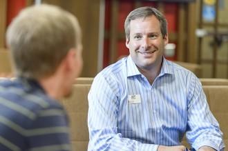 Photo: Jeff Novak talking to student