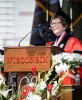 Photo: Rebecca Blank in academic regalia speaking at podium