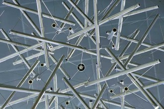 """Photo: """"Sixty Strut Tensegrity Sphere,"""" a nine foot diameter sculpture made of stainless steel tubing and wire by R. Buckminister Fuller, hangs in the Engineering Centers Building atrium."""