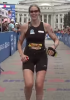 Photo: Woman runner finishing Ironman
