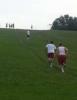 Photo: Basketball players running up Elver Park hill