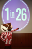 Photo: Bucky Badger pointing to 1 in 26 sign