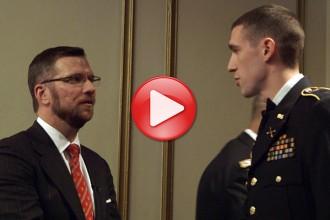 Photo: John Hall speaking to ROTC student