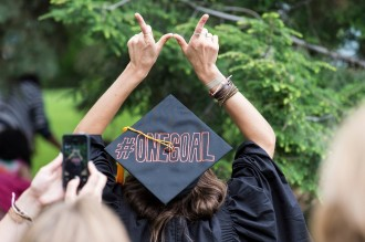 Photo: Graduate's cap says #ONEGOAL