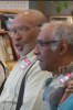 Photo: Elderly men singing