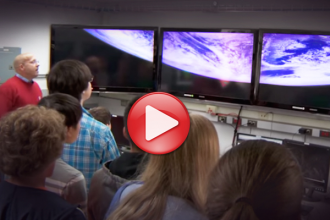 Photo: Students looking at Earth on TV screens