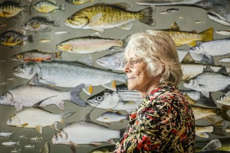 Photo: Kandis Elliot in front of fish poster