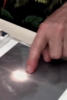 Photo: Finger pointing at UFO in photo