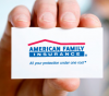 Photo: Hand holding American Family Insurance card