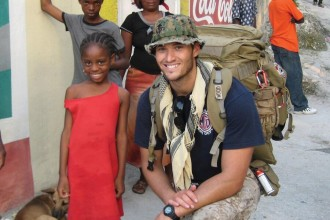 Photo: Jake Wood with Haitian girl