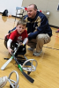 Photo: Volunteer and child playing sledge hockey
