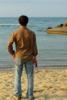 Photo: Man standing along shoreline