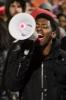 Photo: Protestor speaking into bullhorn