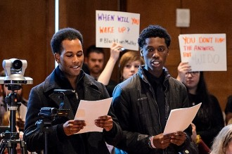 More than 50 people aligned with the Black Lives Matter Movement hold signs of protest, voice their concerns about racial inequity on UW System campuses and briefly disrupt a UW System Board of Regents meeting at Union South at the University of Wisconsin-Madison on Feb. 5, 2016. (Photo by Jeff Miller/UW-Madison)