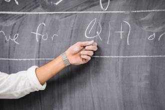 Photo: Daniel Erman writing on chalkboard
