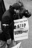 Photo: Protestor with Stop the Bombing sign