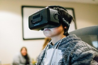 Photo: Student wearing virtual reality glasses