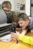 Photo: Students measuring wind speed in classroom
