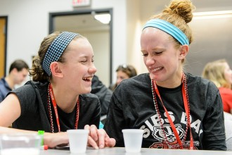 UW-Madison student Melissa Stalowski (right) and younger sister Lucy Stalowski (left) test if a substance might be DNA by trying to dissolve it in water during a hands-on Biotrek Science Workshop in the Genetics and Biotechnology Building during Sibs Day at the University of Wisconsin-Madison on April 9, 2016. Sibs Day is an event hosted by the UW Parent Program that features a fun-filled day of activities for students and their siblings to experience campus together.(Photo by Bryce Richter / UW-Madison)