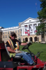 Photo: Worker on lawn mower in front of Bascom Hall