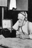 Photo: Man listening to radio in the 1920s