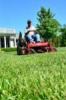 Photo: Man mowing lown