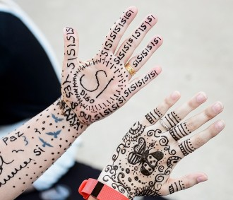 Photo: Closeup of hands with henna designs