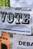 "Photo: ""Vote"" poster on bulletin board"