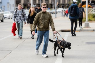 Photo: Drew Hasley with guide dog Shade