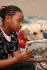 Photo: Child reading to dog