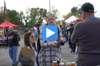 Photo: Students talking to man at farmers market