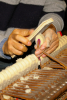 Photo: Technician sanding piano key hammers