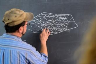 Photo: Peter Krsko drawing on chalkboard