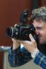 Photo: Man using camera