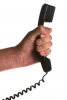 Photo: Man holding corded phone receiver