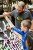 Photo: Grad student showing child a science exhibit