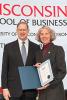 Photo: Professor Joan Schmit accepting award